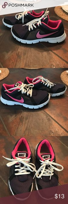 Nike girls shoes 4.5 Big Kids Big kids black and pink Nike tennis shoes size 4.5 in good condition! Nike Shoes Sneakers