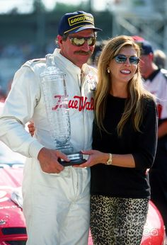 Dale Earnhardt Sr and wife Teresa Earnhardt pose for pictures. Teresa Earnhardt, Dale Earnhardt, Dale Earnhart Jr, The Intimidator, Nascar Race Cars, Chase Elliott, Famous Couples, Sports Figures, Poses For Pictures
