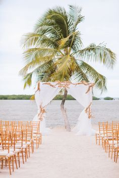 beach ceremony with our gold chiavari chairs