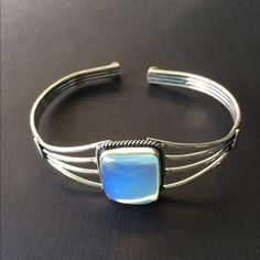 Nice Opalite and Silver Cuff Bracelet Very Pretty Opalite and Silver Cuff Bracelet color changes from white to a beautiful sky blue Adjustable band small silver heart on each side Jewelry Bracelets