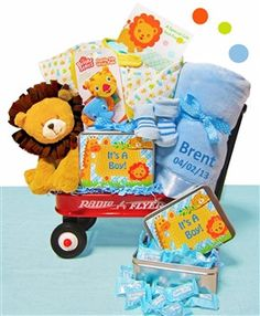 """A jungle themed baby gift is designed in a mini Radio Flyer wagon. (12 5/8"""" x 7 5/8"""" x 2). Comes with a Plush Lion and two wrist rattles for baby. Choose personalization and your baby blanket will be www.TopsyTurvyDiaperCakes.com * diaper cakes for baby shower & washcloth favors"""
