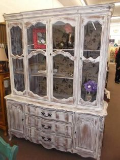 $335 - Shabby white French Provincial china hutch with Paris themed burlap lining. Three drawer and 2 cabinets on bottom - 3 cabinets with glass on top.  ***** In Booth H12 at Main Street Antique Mall 7260 E Main St (east of Power RD on MAIN STREET) Mesa Az 85207 **** Open 7 days a week 10:00AM-5:30PM **** Call for more information 480 924 1122 **** We Accept cash, debit, VISA,