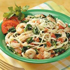 Fettuccine with Shrimp, Spinach, Plum Tomatoes and Garlic. OK, but I agree with the reviewer that said it was a little bland. Second time I used 9, yes 9 cloves of garlic, up the tomatoes to 6, and added white wine and fresh basil. It was quite yummy!