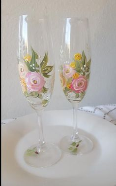 Hand painted glass champagne flutes. A beautiful memento for bride and groom.