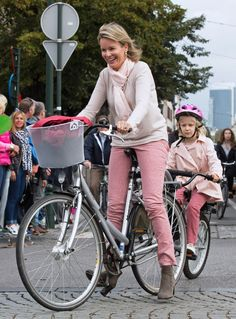 Queen Mathilde takes a bike ride around the centre of Brussels with her children on 'Car Free Sunday' in September last year.