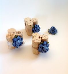 Hot glue wine corks together, adorn with ribbon and flowers, cut place for cheese card.