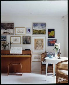 I like how children and adult art is mixed.  I would love a music and art corner like this.