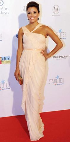 Look of the Day › August 13, 2011 WHAT SHE WORE Eva Longoria hosted the Starlite Gala in a draped gown accented with tiered Irene Neuwirth danglers and a gold box clutch. WHY WE LOVE IT A pale pink hue and sparkling accessories brought out the star's fresh summer glow.