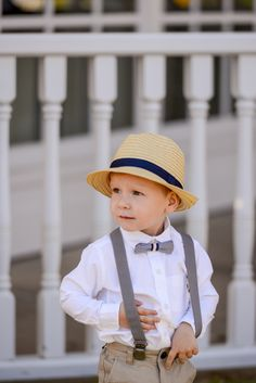 That cute bowtie and overalls..how cute is this little Walt Disney World attendant?