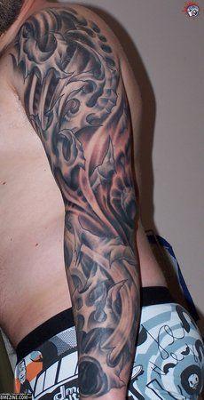 Awesome Bio Mechanical/Organic/Anatomical tattoos.  Source: Unknown.