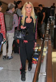 Traveling in casual style: Tara Reid decided to dress for comfort, wearing baggy gym cloth...