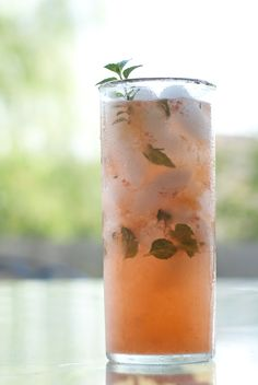 Peach Mojito  1.5 oz white rum (Myer's is my favorite)  1 small, ripe peach, skin removed and sliced  small handful fresh mint leaves  juice of 1 lime  1 teaspoon raw (turbanado) sugar  club soda.. BET THIS IS AMAZING!