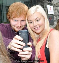 Ed Sheeran Signs autographs and poses for photographs with fans during a radio promo tour http://icelebz.com/events/ed_sheeran_signs_autographs_and_poses_for_photographs_with_fans_during_a_radio_promo_tour/photo2.html