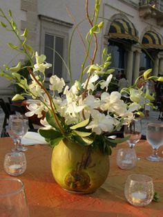 Dendrobium orchids and coconut centerpieces