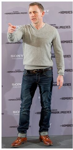Daniel Craig casual with vneck sweater and denims