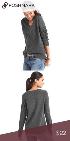 GAP Cozy V-Neck Sweater Comfy and soft grey cashmere blend sweater from the GAP. This piece has been gently worn and shows mild signs of wear but no defects. It is an XS, measures 18 inches from underarm to underarm and 26.5 inches from shoulder to hem. GAP Sweaters V-Necks