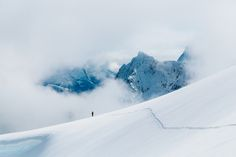 Skiing over the fjords of Sunnmore Alps, Norway.