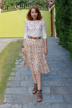 Floral top worn with floral skirt