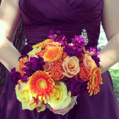 Our orange and purple flowers with our Bill Levkoff Eggplant satin gowns for this amazing fall wedding.