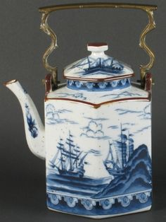 "BLUE AND WHITE TEA KETTLE Blue and white ceramic tea kettle with brass swing handle, six sided form with sailing ship decoration, body with brown speckles and brown trim decoration. No mark. Size: 12""H, 9""W, 7 1/2""D. Condition: minor wear."