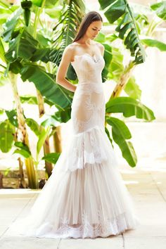 I love the romanticism the bottom of this dress creates. This reminds me of getting married at someone's villa.
