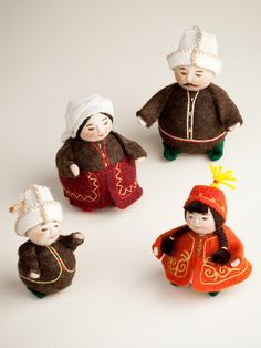This cheerful family is handmade in Kyrgyzstan out of felt, a thick fabric produced by application of heat, water, and pressure for the meshing together of wool fibers. The women dye the felt pieces a