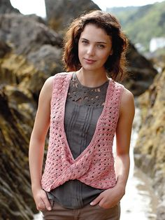 Sencha - Knit this women's deep V vest with twisted front from the Tetra Cotton Collection, a design by Lisa Richardson using the exquisite yarn Tetra Cotton (cotton). Knitted in an openwork pattern, with a plunging V neck accentuated by a twist at the bottom of the V. This knitting pattern has a three star difficulty rating.