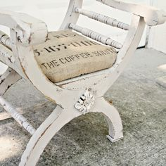 white vintage distressed stool with linen cushion Repinned by www.silver-and-grey.com