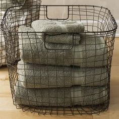 Wire Baskets In The Powder Room One Below Sink And On Floating Shelves