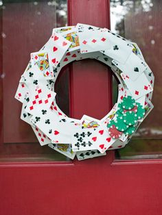 Poker fans will get a kick out of repurposing a deck of cards as a cheery holiday wreath. Create multiple layers of cards with thick mounting tape; this gives the wreath more dimension. For added whimsy, attach red and green poker chips in one corner to resemble a sprig of holly. Design by Brian Patrick Flynn