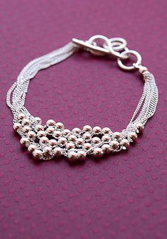 Beaded Bracelet:silver chain and use my large-holed round silver beads with large lobster clasp.