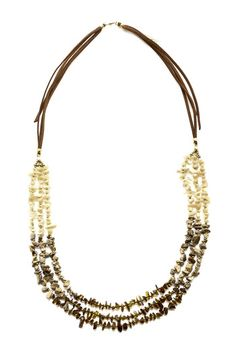 """Three strand beaded necklace with suede. Mother of pearl, picture jasper and smokey quartz chips. Gold plated bead accents. Handmade in Thailand. Measures:32"""" with a 2"""" extender."""