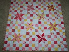 Strawberry Baby Quilt ~ in pinks, reds, yellows; *no pattern   via Polka Dot Quilts