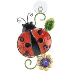 Sun Catcher Window Decor Ladybug - Regal Art #10184 by Regal Art and Gift. $14.37. Use Of Richly Colored Automobile Paint Creates Quality, Durable Finish.. Mix And Match Items In Same Or Different Themes.. Special Painting Techniques Creates A 'Patina' Effect.. Extensive Handcrafting Is Put Into Each Piece.. This Sun Catcher Window Decor Ladybug - Regal Art #10184 adds color and whimsy to any window or mirror. The glass body lets the light filter through, while the metal fra...