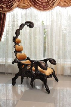 "A ""throne"" shaped like a Scorpion: just the perfect thing to greet people entering my evil villain lair. This chair is the work of painter, sculptor, and wo"