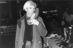 Andy Warhol kissing a shoe