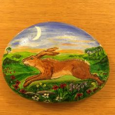 Running Hare. Acrylic painting on North Devon beach stone. Larger than a palm stone but pleasant to handle.