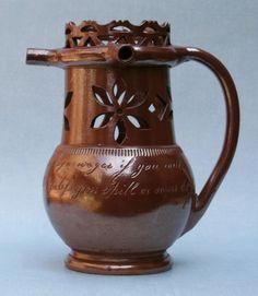 Salt glazed puzzle jug. early C19th.