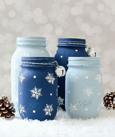 Snowflake mason jars. Stamped mason jars. Painted mason jars with snowflake stamped design. Includes tutorial and picture instructions.