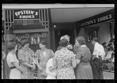 Women talking in front of Epstein's Shoe Store on Main St., Lancaster in the summer of 1938.