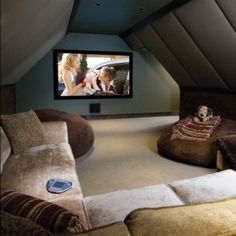 Finished attic that serves as a home theater, how inviting :)