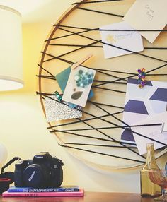 DIY: embroidery hoop card catcher - good prop for display paper goods at a craft fair.