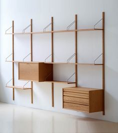 Beautiful reproductions of Cadovius' 1948 Royal System modular shelving are now available. We take a close look at this classic midcentury modern shelving -- being made again today in Denmark -- and for sale in the U. at Design Within Reach. Wall Shelving Systems, Shelving Design, Modular Shelving, Shelf System, Storage Shelving, Office Shelving, Shelving Ideas, Modular Bookshelves, Shelving Display