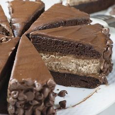 Zoomed piece of Hershey Cheesecake Chocolate Cake in plate with whole sliced cake.