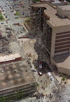 Rescue personnel converge on the bomb-damaged Alfred Murrah Federal Building in Oklahoma City Wednesday, April 19, 1995.