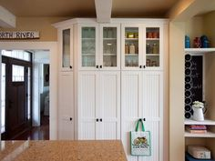 Great bank of kitchen cabinet/pantry storage, and I really like the angled cabinet on the left.