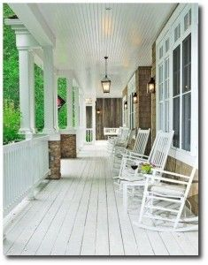 The Loooooooong Porch. Love this one. I love the banister, the white floor beams that are worn just the perfect amount, the row of rocking chairs, the lanterns and the bead board on the ceiling.