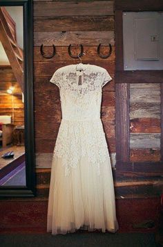 Mismatched vintage lace dresses & boots for the bridesmaids w/ simple baby's breath bouquets wrapped in twine.