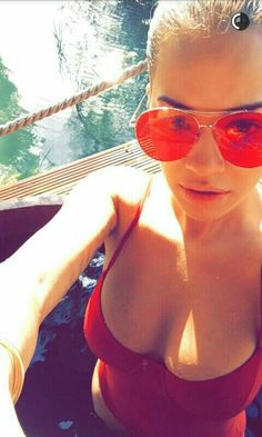 Red hot: Rita Ora, certainly set pulses racing in a busty close-up selfie of herself in a sexy red swimsuit Famous Celebrities, Celebs, Snapchat News, Red Swimsuit, Blonde Bobs, Rita Ora, Oras, Hottest Models, Sunglasses Women