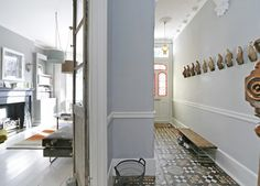 Victorian terraced house: hallway and living room. Soft grey palate with low picture rail dividing wall.
